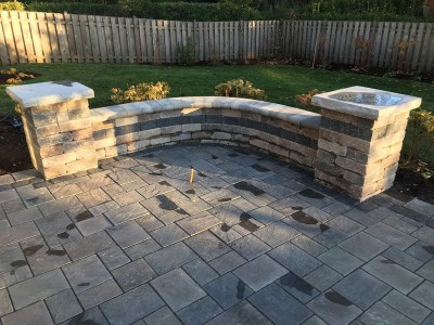 Richcliff paver patio by Unilock and Brussels Dimensional seat wall and pillars