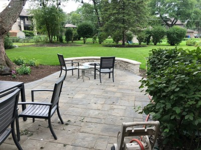Beacon Hill paver patio with Rivercrest fire pit and seat wall by Unilock