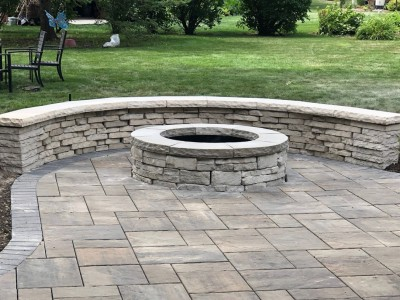 Rivercrest seat wall and fire pit by Unilock