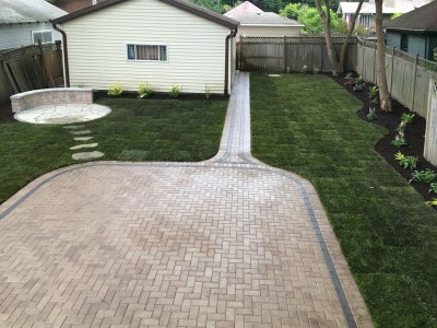 Paver patio flagstone patio seat wall grading new sod and landscaping