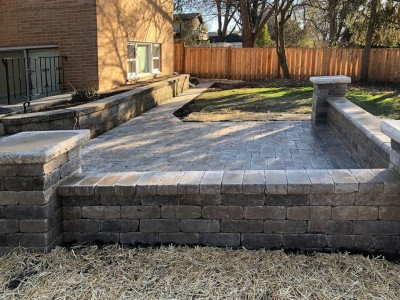 Brick paver patio seat wall and pillars using Brussels Block and Brussels Dimensional Stone by Unilock