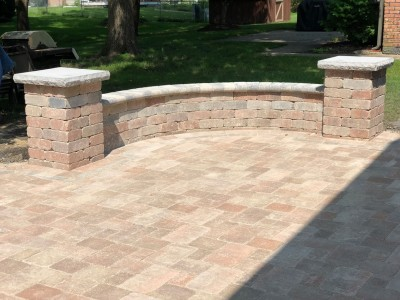 Paver patio seat wall and pillars using Brussels Block and Brussels Dimensional Stone by Unilock7